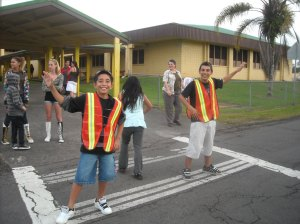 Koliah Hatori, 11 and Trey Guerra, 13 man the crosswalks