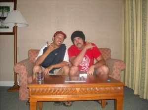 Some dude and Aric kicking back on the couch at the Waikoloa