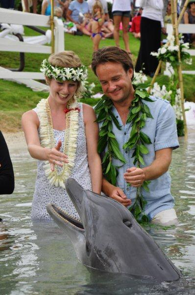 Alex and Lisa get married with a dolphin looking on