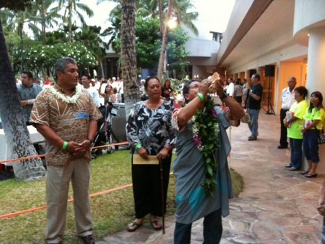 Mayor Kenoi and Senator Hanohano look on as Dan Akaka Jr. blows the conch opening the 2011 Taste of the Hawaiian Range