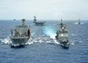 The Military Sealift Command fleet replenishment oiler USNS Henry J. Kaiser (T-AO 187), left, delivers a 50-50 blend of advanced biofuels and traditional petroleum-based fuel to the guided-missile cruiser USS Princeton (CG 59) during the Great Green Fleet demonstration portion of Rim of the Pacific (RIMPAC) 2012 exercise. In the background are the aircraft carrier USS Nimitz (CVN 68) and the guided-missile destroyer USS Chung-Hoon (DDG 93). Twenty-two nations, more than 40 ships and submarines, more than 200 aircraft and 25,000 personnel are participating in the biennial RIMPAC exercise from June 29 to Aug. 3, in and around the Hawaiian Islands. The world's largest international maritime exercise, RIMPAC provides a unique training opportunity that helps participants foster and sustain the cooperative relationships that are critical to ensuring the safety of sea lanes and security on the world's oceans. RIMPAC 2012 is the 23rd exercise in the series that began in 1971. (U.S. Navy photo by Mass Communication Specialist Seaman Apprentice Ryan J. Mayes/Released)
