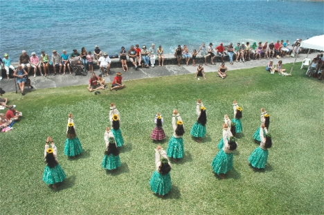 Hula Dancers dance behind Hulihe'e Palace. (Photo Fern Gavalek)