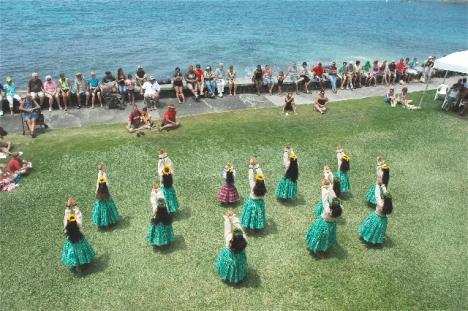 Hula Dancers dance behind Hulihe'e Palace. (Photo Fern Gavalek)