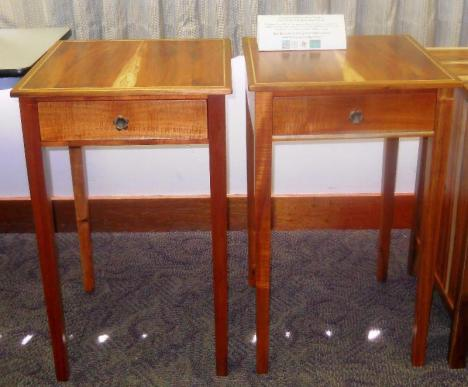 Matching young-growth koa end tables by Ron Hester displayed at symposium.