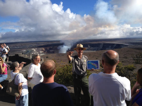 "Park Ranger Dean Gallagher engages visitors with a ""Life on the Edge"" talk, held daily at the Jaggar Museum Overlook in Hawai'i Volcanoes National Park. NPS Photo"