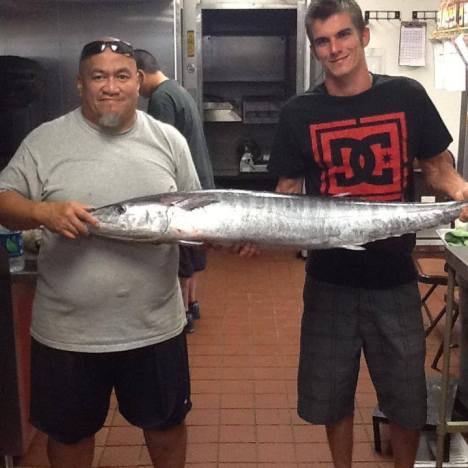 Picture: Chef Thoma (on left) receiving a fresh caught Ono for his restaurant