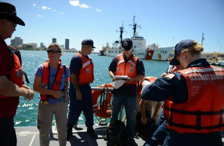 Crewmembers from the Coast Guard National Strike Force head to their first location to use a water quality instrument used to monitor depleted oxygen and pH levels in Honolulu Harbor, Honolulu, Sept. 15, 2013. Personnel from the Coast Guard, U.S. Environmental Protection Agency, U.S. Fish and Wildlife, National Oceanic and Atmospheric Administration tested the water at various locations around Honolulu Harbor affected by the molasses spill. (U.S. Coast Guard photo by Petty Officer 3rd Class Tara Molle)