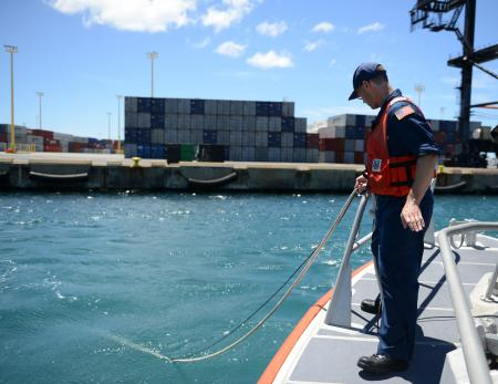 Coast Guard Petty Officer 1st Class James Moore with the National Strike Force Atlantic Strike Team, handles a water quality instrument used to monitor depleted oxygen and pH levels in the Honolulu Harbor, Honolulu, Sept. 15, 2013. Personnel from the Coast Guard, U.S. Environmental Protection Agency, U.S. Fish and Wildlife, National Oceanic and Atmospheric Administration tested the water at various locations around Honolulu Harbor affected by the molasses spill. (U.S. Coast Guard photo by Petty Officer 3rd Class Tara Molle)