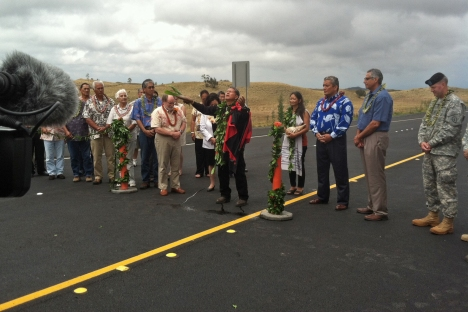 Governor Neil Abercrombie, Hawaii County Mayor Billy Kenoi, Mrs. Irene Inouye, and members of the Saddle Road Task Force assist in dedicating the new segment of the former Saddle Road, a nine-mile stretch linking Mile Post 42 to Mamalahoa Highway (Route 190).