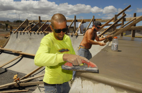 Brian Sandlin, left, and Michael Moore, Jr. work on the coping and deck of the final quarter pipe of Kamakoa Nui Park. Grand opening is September 29 from 12 to 4 p.m.  Photo by Robin Christman for Waikoloa Community Development Corp./Transition Youth Project