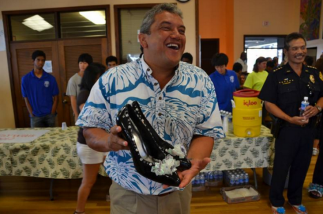 Mayor Kenoi holding his selected pair of heels for the 2012 Walk-a-Mile event