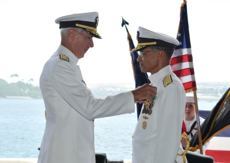 Adm. Locklear pins the Distinguished Service Medal on Adm. Cecil D. Haney during the ceremony. (U.S. Navy photo by Mass Communication Specialist 2nd Class David Kolmel)