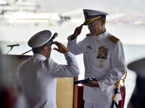 Adm. Haney accepts his pennant from U.S. Pacific Fleet Master Chief Marco Ramirez during the change of command ceremony. (U.S. Navy photo by Mass Communication Specialist 1st Class Daniel Barker)