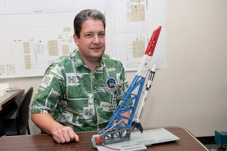 Hawaii Space Flight Laboratory Director Luke Flynn with a model of the launcher and Super Strypi launch vehicle.