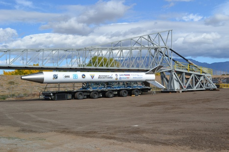 The rail launcher to be used in Hawai'i's first space launch is unveiled in Albuquerque, New Mexico. Attached to the rail launcher is a scale model of the Super Strypi rocket that will carry a satellite constructed by University of Hawai'i faculty and students. The launcher will be disassembled and transported to the 2014 launch site at the Pacific Missile Range Facility (PMRF) on Kaua'i. Photo credit: Sandia National Laboratories.