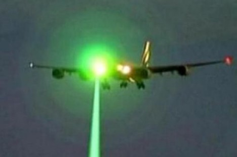 A green laser shining on an aircraft. Photo courtesy of Department of Transportation