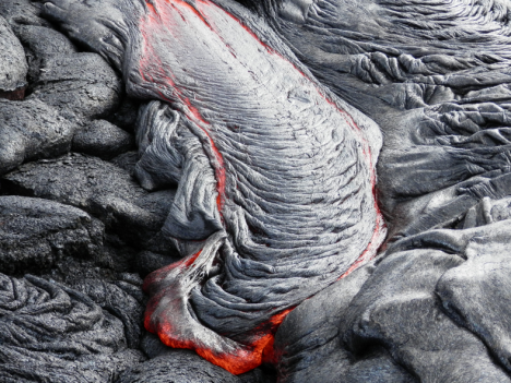 This photo shows a nice example of ropy pāhoehoe active near the flow margin.