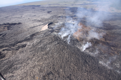 The lava tube feeding the Kahaualeʻa 2 flow extends from the northeast spatter cone down the north flank of Puʻu ʻŌʻō, in a direct line towards the lower right corner of the photo.   Click to Enlarge