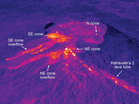 This thermal image shows Puʻu ʻŌʻō (see visual photograph at left for equivalent view). Recently, the southeast and northeast spatter cones have produced small overflows out of the crater, shown clearly here by their warm temperatures. The vent for the Kahaualeʻa 2 flow is at the northeast spatter cone, and the lava tube supplying the Kahaualeʻa 2 flow is obvious as the line of elevated temperatures extending to the lower right corner of the image.  Click to Enlarge