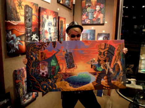 "Brad holding his original art piece ""Forbidden Island""."