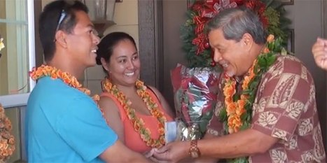 Gerry Durante and Shyanne Parong get the keys to their new home from Hawai'i County Managing Director Wally Lau