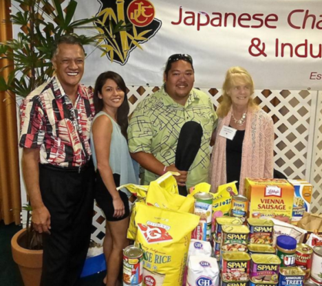 Francis Rickard, Hilo Hawaiian operations manager, JCCIH's social chair Gina Tanouye, Mark Yamanaka, entertainer, and Carol VanCamp, JCCIH president, with the collected food for The Food Basket.