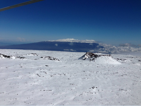 Search-and-rescue pilot David Okita shows snow-covered Mauna Loa and the cindercone Pohaku o Hanalei in foreground, near where Sverdlov was spotted. Snow-covered Mauna Kea is seen in the distance.