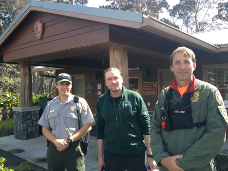 Rescued hiker Alex Sverdlov (middle) stands with his rescuers, park ranger John Broward (right) and park ranger Tyler Paul (left) outside the park's Visitor Emergency Operations Center on Thursday.  NPS Photo/J.Ferracane
