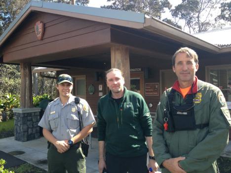 Rescued hiker Alex Sverdlov (middle) stands with his rescuers, park ranger John Broward (right) and park ranger Tyler Paul (left) outside the park's Visitor Emergency Operations Center on Thursday.  NPS Photo/J.Ferracane