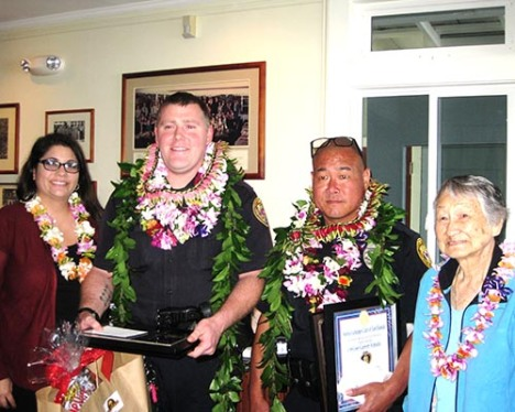 Officer Joshua Gouveia, second from left, with his wife, Emmalyn Gouveia, and Officer Garret Hatada with his grandmother, Yasuko Hatada, pose after being recognized by the Aloha Exchange Club of East Hawai'i.