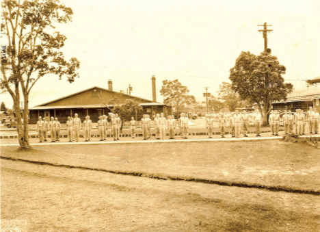 U.S. Army Signal Corps, 1940s. Building 34 in background used to intern Japanese Americans during World War II (Kilauea Military Camp photo)