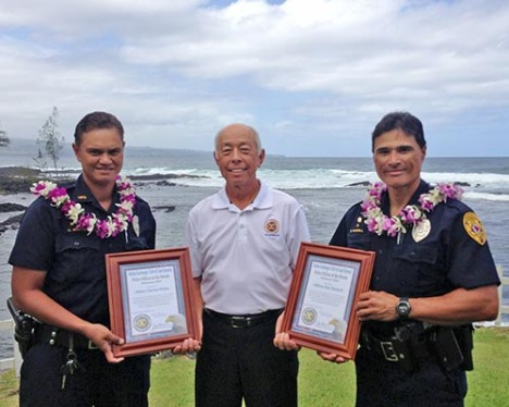 "Hilo Exchange Club board member Joey Estrella presents ""Officer of the Month"" awards to Charrise Wakita and Earl Haskell"