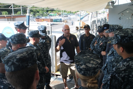 Lake Erie Commanding Officer Capt. John S. Banigan talks to some of his crew.